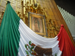 Juan Diego's tilma with some not-so-subtle symbolism below.